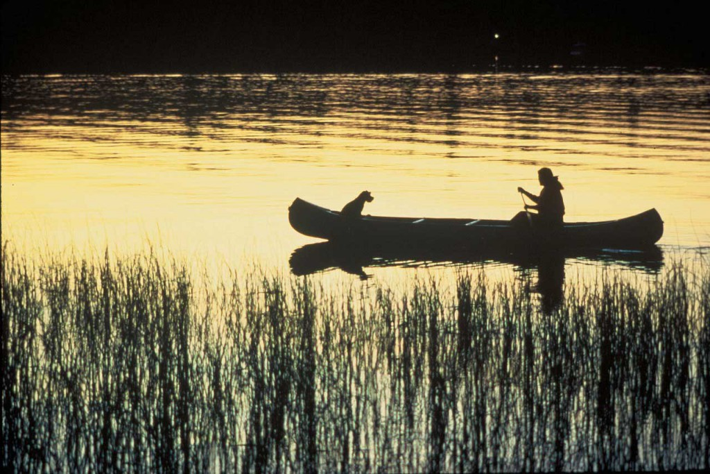 Affiliate marketing allows you time to relax at sunset in you canoe